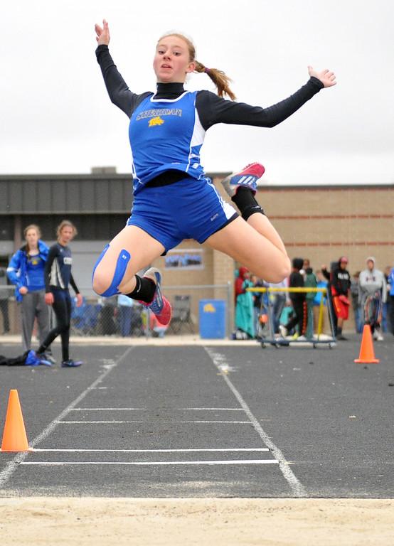 Peyton Bomar jumps toward the pit during the long jump event Saturday at Sheridan High School. Bomar won the event. Mike Pruden | The Sheridan Press