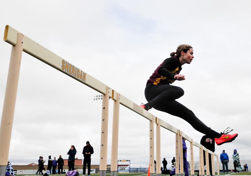 Big Horn's Bailey Bard clears a hurdle during the Dan Hansen Invitational Saturday at Sheridan High School. Justin Sheely/The Sheridan Press.