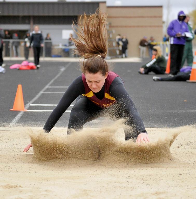 Big Horn long jumper Morgan Nance hits the pit after a jump Saturday at Sheridan High School. Mike Pruden | The Sheridan Press