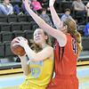 Tamara Brine bumps into a Casper defender Friday at Sheridan College. Mike Pruden   The Sheridan Press