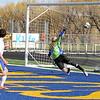 Noah Iberlin, left, kicks the ball past Gillette goalkeeper Andrew Hays for Sheridan's second goal Thursday at Scott Field. Mike Pruden | The Sheridan Press