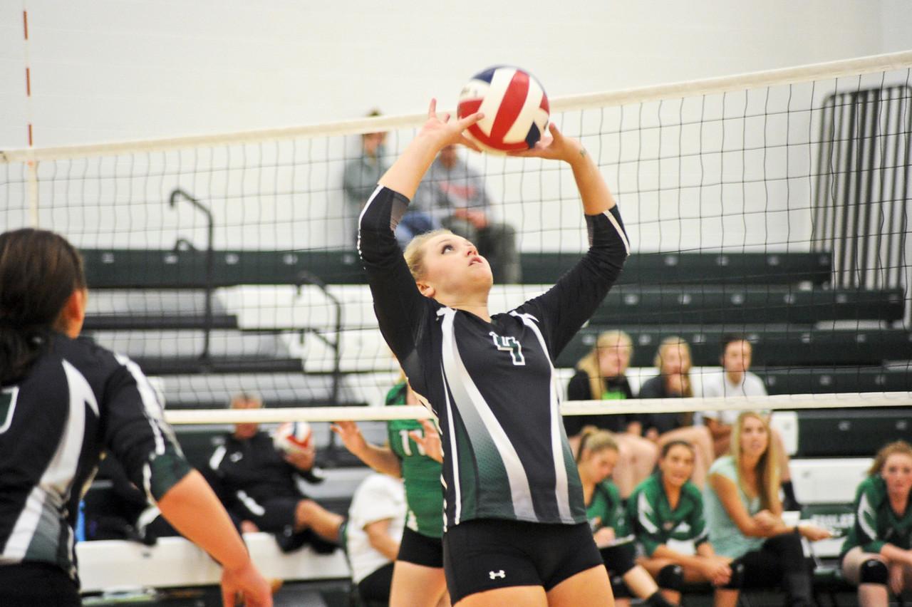 Madison Boll sets the ball against Moorcroft Thursday at Tongue River High School. Mike Dunn | The Sheridan Press.