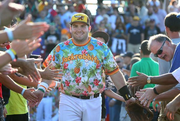 8-6-15<br /> Jackrabbits vs Sliders<br /> Shea Molitor smiles as he runs through the tunnel during the lineup.<br /> Kelly Lafferty Gerber | Kokomo Tribune