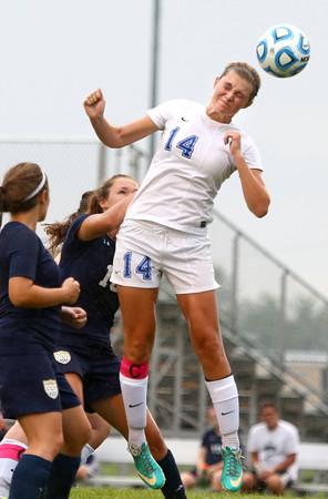 8-19-15<br /> Kokomo vs Oak Hill soccer<br /> Taylor Coram head butts the ball.<br /> Kelly Lafferty Gerber | Kokomo Tribune