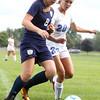 8-19-15<br /> Kokomo vs Oak Hill soccer<br /> Oak Hill's Sarah Wood and Kokomo's Aaryan Morrison battle over control of the ball.<br /> Kelly Lafferty Gerber | Kokomo Tribune