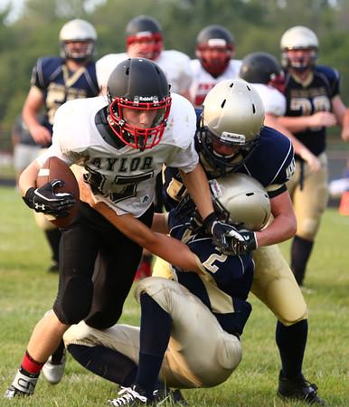 8-14-15<br /> Taylor vs Oak Hill scrimmage<br /> Caleb Murdock tries to get out of the grasp of Oak Hill defenders.<br /> Kelly Lafferty Gerber   Kokomo Tribune
