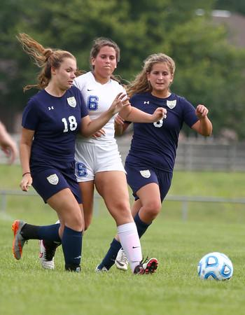 8-19-15<br /> Kokomo vs Oak Hill soccer<br /> Kokomo's Grace Cameron is flanked on both sides by Oak Hill's Zoe Smith and Tallia Morris.<br /> Kelly Lafferty Gerber | Kokomo Tribune