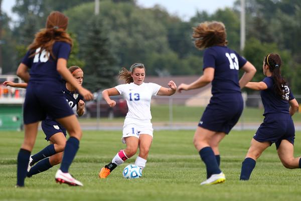 8-19-15<br /> Kokomo vs Oak Hill soccer<br /> Katelyn Van Horn looks for an opening around Oak Hill for a pass.<br /> Kelly Lafferty Gerber | Kokomo Tribune