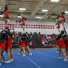 Stunt groups during round 2 of the competition.  Flyers left to right are Senior Lindsey Hensley, Freshman Carlee Huffman, Junior Tori Cook, and Freshman Savannah Baugher