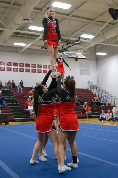 Junior Tori Cook on top of a stunt in round 2 of the competition