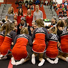 Cheerleaders and Coaches react to announcement that East Rock wins Region 2A East.