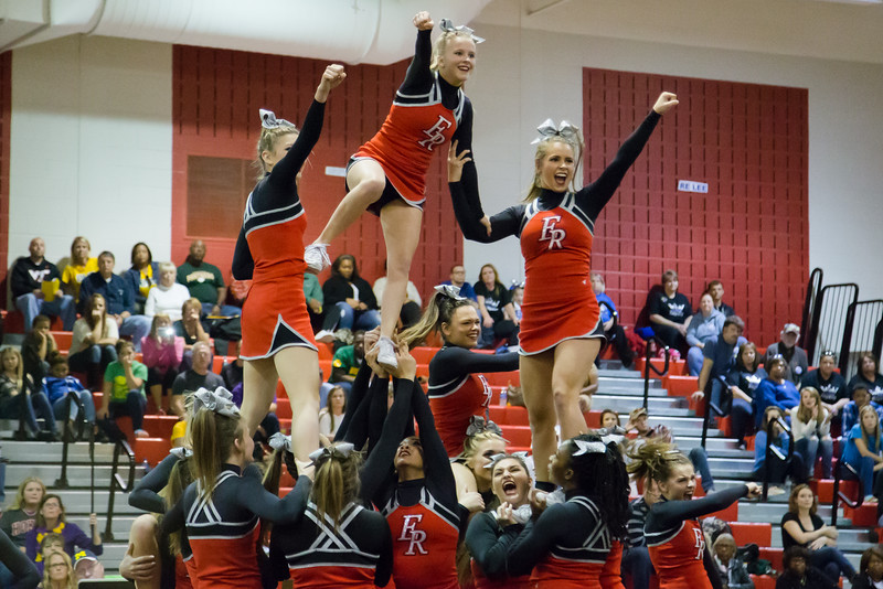 ERHS Cheerleaders performing in round 1 of Region 2A meet.  Junior Tori Cook on top of pyramid with Freshman Savannah Baugher (left) and Senior Lindsey Hensley (right)