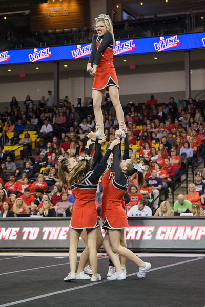 ERHS Cheer performing in round 1 at State Championships. Freshman Savannah Baugher atop stunt group.