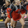 ERHS Cheer performing during round 1 at State Championships. Left to Right, Senior Lindsey Hensley, and Junior Tori Cook