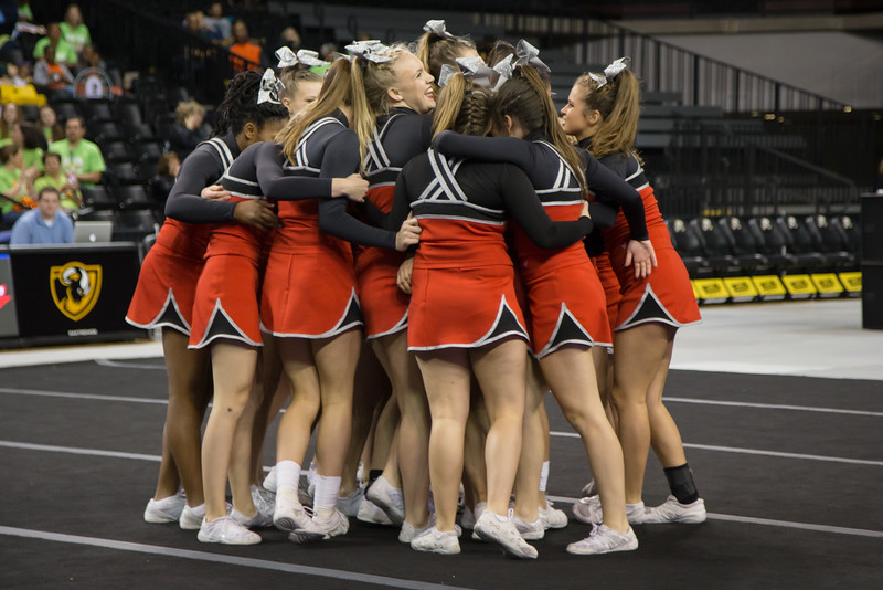 After the second round routine the team meets at center mat for one last time this season.
