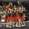 ERHS Cheer performing during round 2 at State Championships.   Left to Right Freshman Savannah Baugher, Junior Tori Cook (center) and Senior Lindsey Hensley