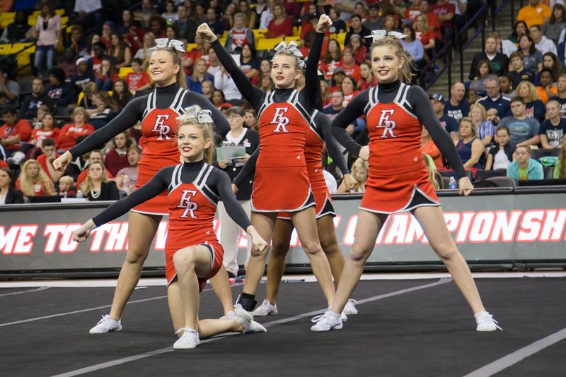 ERHS Cheer performing in round 1 at State Championships. Left to Right Senior Alyssa Breeden, Freshman Savannah Baugher, Freshman Maggie Ferrell, and Freshman Grace Rogers