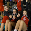 Freshman Grace Rogers, Sophmore Cara Lasam, and Freshman Carlee Huffman (Left to Right) react to the announcement of ERHS' first round score.
