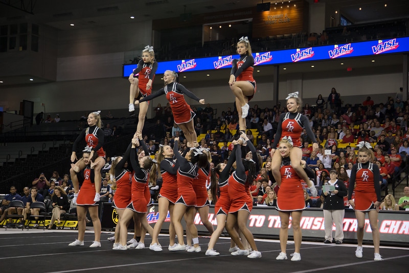 ERHS Cheer performing pyramid stunt during round 1 at State Championships. Junior Tori Cook coming down out of the stunt.