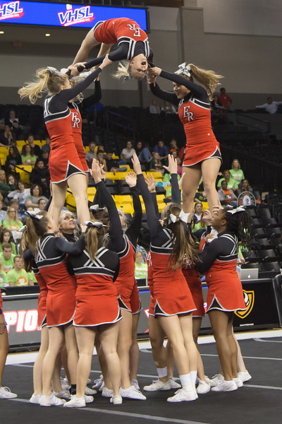 ERHS Cheer performing during round 2 at State Championships.   Left to Right Freshman Savannah Baugher, Senior Linzzee Williams (back center), Junior Tori Cook (front center) and Senior Lindsey Hensley