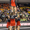 ERHS Cheer performing during round 2 at State Championships.  Freshman Carlee Huffman goes up in a stunt group.