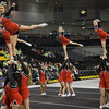 ERHS Cheer performing during round 2 at State Championships.  Left to Right Senior Lindsey Williams, Freshman Savannah Baugher, Junior Tori Cook