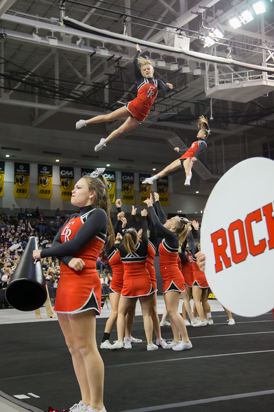 ERHS Cheer performing in round 1 at State Championships.  Front is Senior Abby Borg, Middle in air is Junior Tori Cook, back in air is Freshman Carlee Huffman