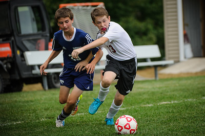 Middle school soccer match between Sanborn (blue) and Derryfield (white) held on September 28, 2015 at the The Derryfield School in Manchester, NH.