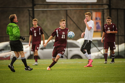 Varsity soccer division IV championship game between Moultonborough Academy (white) and Derryfield (maroon) held on November 7, 2015 at the Southern NH University in Manchester, NH.
