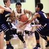 12-22-15<br /> Western vs Oak Hill boys basketball<br /> Western's Jeffrey McClung looks to get past Oak Hill's defense.<br /> Kelly Lafferty Gerber | Kokomo Tribune