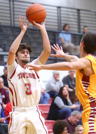 12-15-15<br /> Taylor vs Alexandria boys basketball<br /> Taylor's Malin Vazquez shoots a three.<br /> Kelly Lafferty Gerber   Kokomo Tribune