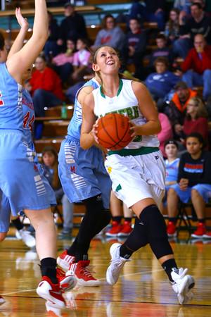 Girls basketball between Eastern HS and Maconaquah HS Dec., 5, 2015. Eastern's Allison Hanner going for a shot in the first quarter.<br /> Tim Bath   Kokomo Tribune