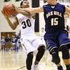 12-22-15<br /> Western vs Oak Hill boys basketball<br /> Western's Jeffrey McClung and Oak Hill's Christian Livingston<br /> Kelly Lafferty Gerber | Kokomo Tribune