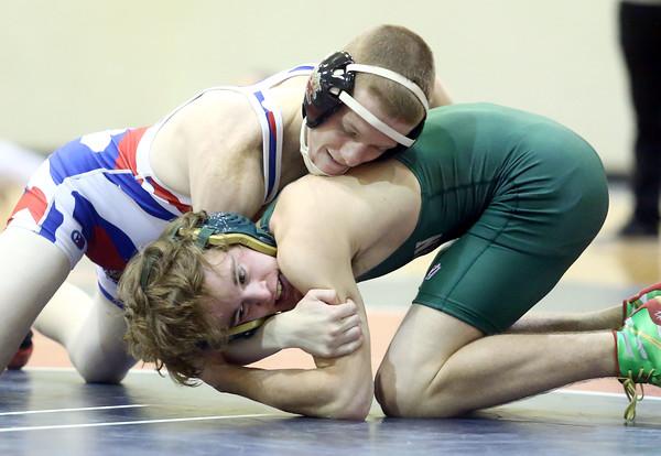 12-2-15<br /> KHS vs EHS wrestling<br /> Kokomo's Seth Johnson and Eastern's Austin Duchateau<br /> Kelly Lafferty Gerber   Kokomo Tribune
