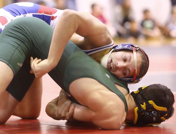 12-2-15<br /> KHS vs EHS wrestling<br /> Kokomo's Szhantrayle Roberson and Eastern's Isaac Maurer<br /> Kelly Lafferty Gerber | Kokomo Tribune
