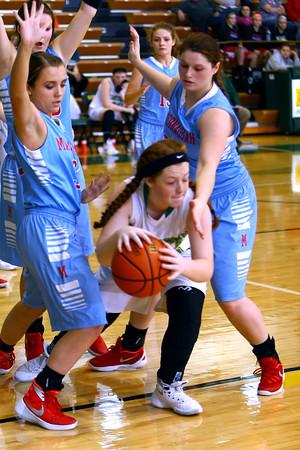 Girls basketball between Eastern HS and Maconaquah HS Dec., 5, 2015. Eastern's Maci Weeks grabs a rebound in the 3rd quarter.<br /> Tim Bath | Kokomo Tribune