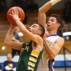 12-11-15<br /> Tri Central vs Eastern boys basketball<br /> Eastern's Zach Robinson and Tri Central's Colby Malson<br /> Kelly Lafferty Gerber | Kokomo Tribune