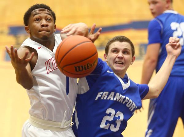12-12-15<br /> Kokomo vs Frankfort boys basketball<br /> Kokomo's Jeron Gray gets fouled by Frankfort's Xavier Frazier after Gray goes for a shot.<br /> Kelly Lafferty Gerber   Kokomo Tribune