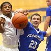 12-12-15<br /> Kokomo vs Frankfort boys basketball<br /> Kokomo's Jeron Gray gets fouled by Frankfort's Xavier Frazier after Gray goes for a shot.<br /> Kelly Lafferty Gerber | Kokomo Tribune