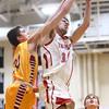 12-15-15<br /> Taylor vs Alexandria boys basketball<br /> Taylor's Darian Stone and Alexandria's Avery Paddock<br /> Kelly Lafferty Gerber | Kokomo Tribune