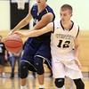 12-22-15<br /> Western vs Oak Hill boys basketball<br /> Oak Hill's Reese Metzger and Western's Cooper O'Neal go after a loose ball.<br /> Kelly Lafferty Gerber | Kokomo Tribune