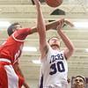 12-18-15<br /> Northwestern vs Maconaquah boys basketball<br /> Maconaquah's Brayden Marley and Northwestern's Trey Richmond<br /> Kelly Lafferty Gerber | Kokomo Tribune
