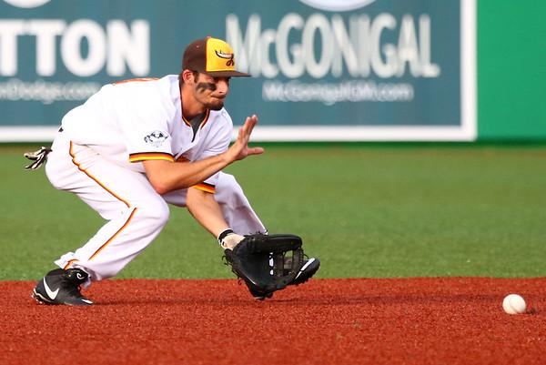 7-18-15<br /> Jackrabbits vs West Virginia<br /> Chris Amato scoops up the ball.<br /> Kelly Lafferty Gerber | Kokomo Tribune