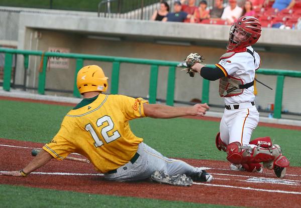 7-18-15<br /> Jackrabbits vs West Virginia<br /> West Virginia's Justin Paul slides home before the Jackrabbits catcher CJ Price can get him out.<br /> Kelly Lafferty Gerber | Kokomo Tribune