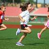 7-4-15<br /> Haynes Apperson Sports<br /> Olivia Carlson, 6, sprints across Kokomo Municipal Stadium's outfield during the Haynes Apperson kids track meet on Saturday morning.<br /> Kelly Lafferty Gerber | Kokomo Tribune