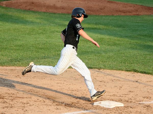 6-9-15<br /> Legion baseball Kokomo vs Plymouth<br /> Josh Jansen crosses third on his way home to score the first point for Kokomo.<br /> Kelly Lafferty Gerber | Kokomo Tribune