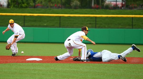 6-17-15 Jackrabbits vs Rex Chris Amato misses the catch for a tag of Rex's 17 as he slides safely to second base. Kelly Lafferty Gerber | Kokomo Tribune
