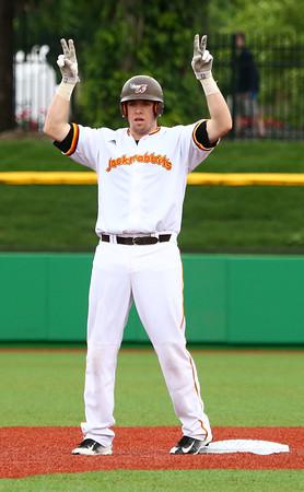 6-17-15<br /> Jackrabbits vs Rex<br /> Chris Folinusz signals a double at second base after he hits one.<br /> Kelly Lafferty Gerber | Kokomo Tribune