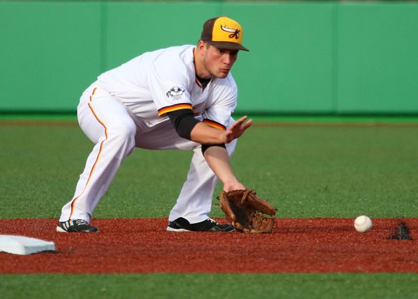 6-11-15<br /> Jackrabbits vs Sliders<br /> Mark Zimmerman scoops up the ball near second.<br /> Kelly Lafferty Gerber | Kokomo Tribune