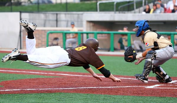 6-30-15<br /> Jackrabbits vs Quincy Gems<br /> CJ Price sails to home base scoring the 5th run for the Jackrabbits.<br /> Kelly Lafferty Gerber | Kokomo Tribune